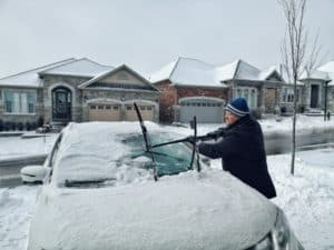 Car windshield being scrapped
