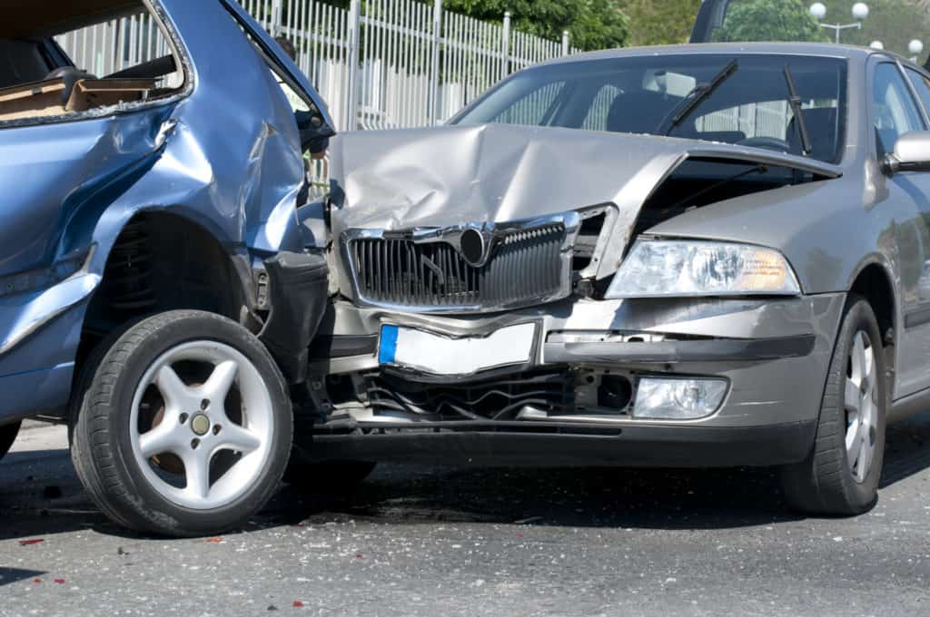 blue and silver cars in a crash
