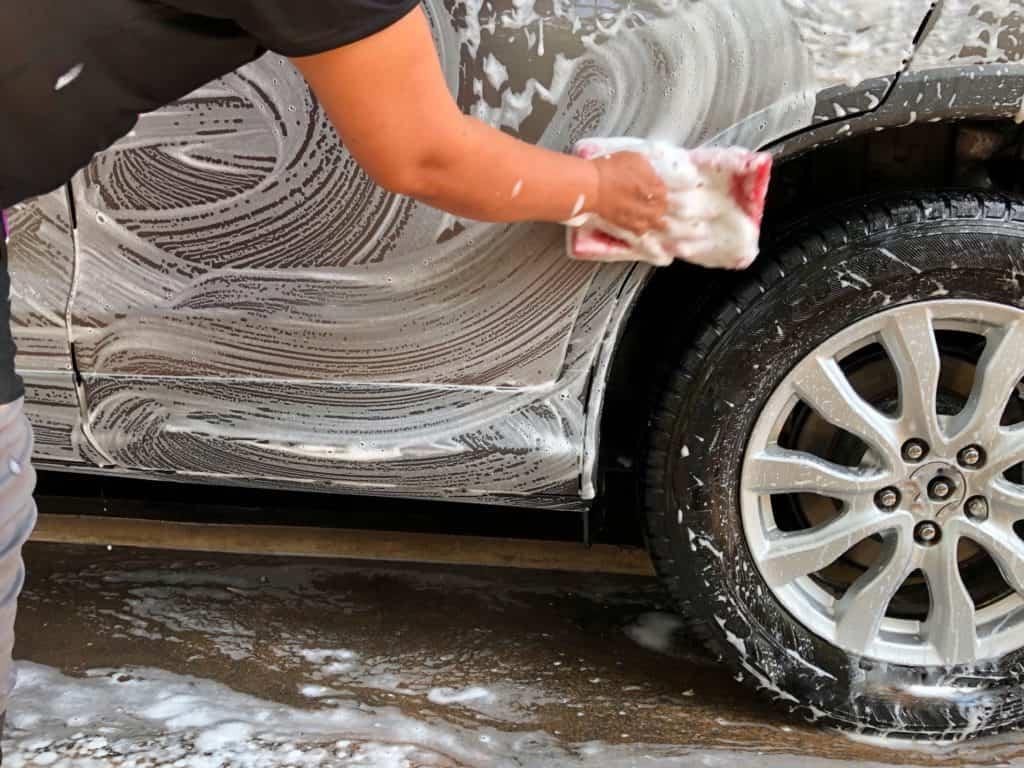 washing a silver car