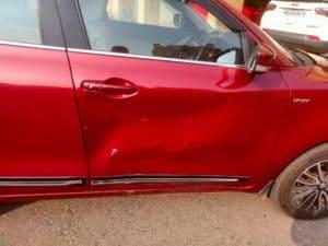 red car with door dent