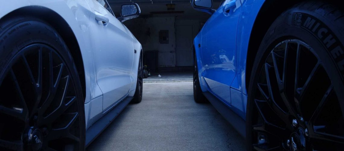blue and white car outside garage