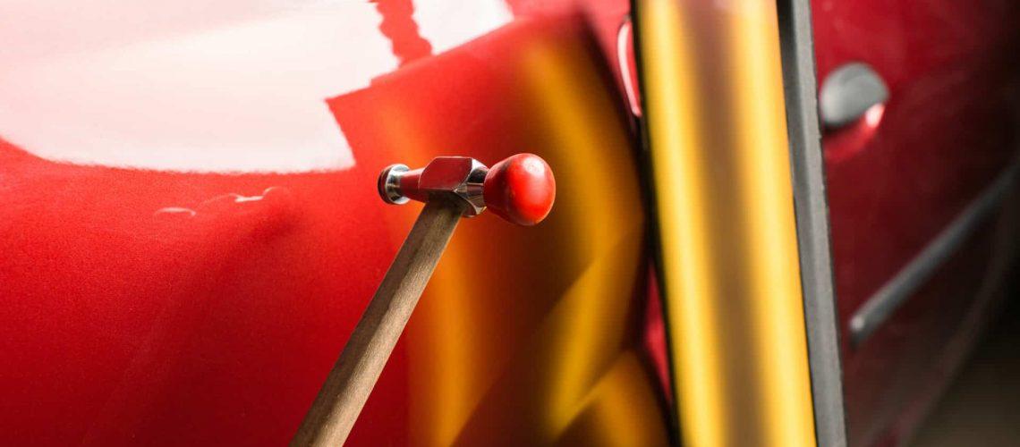 blending hammer on red car
